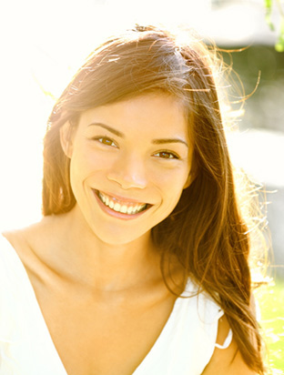Girl with healthy gums thanks to gum disease treatment from a Plano dentist near Frisco and Allen TX.