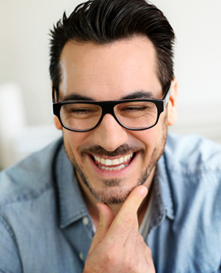 Smiling guy gets cosmetic dentistry procedures done by the highly capable Frisco TX cosmetic dentist Dr. Isabella Mejia.